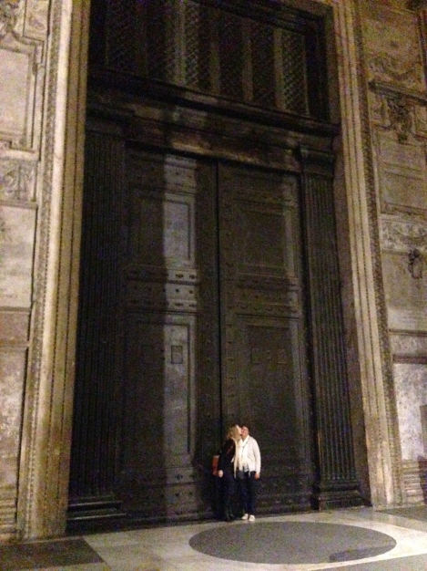 Kisses to Mommy from Me infront of the giant doors to the Pantheon